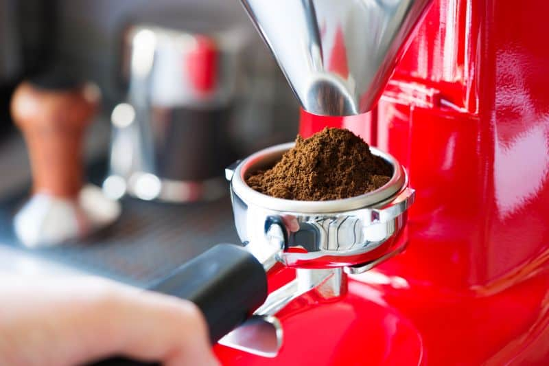 Red coffee grinder with portafilter