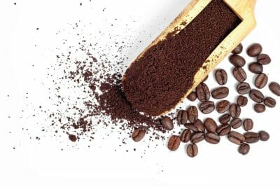 Closeup of whole bean coffee and ground coffee