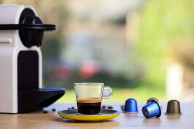 Coffee cup and pod coffee maker