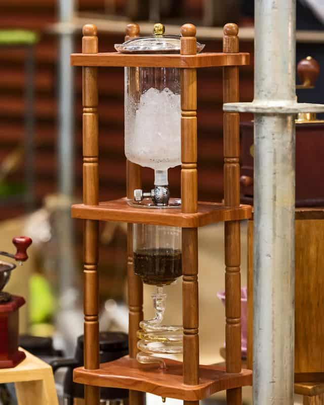 cold filtered coffee maker with wooden stand