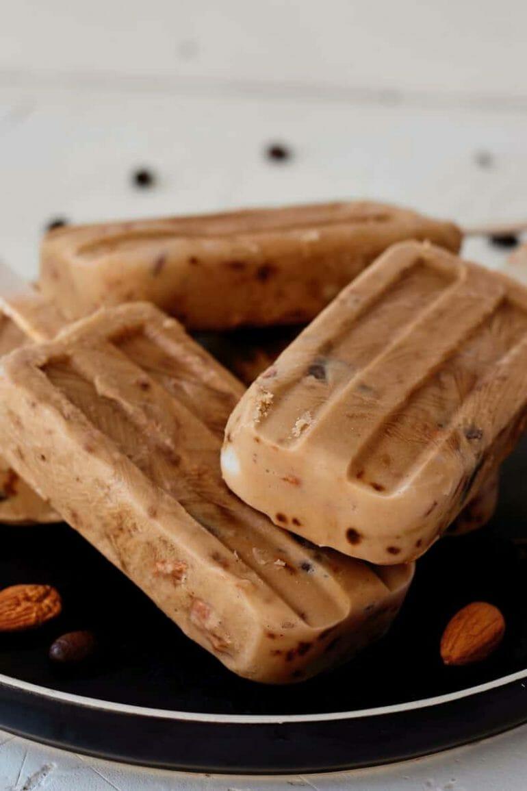 almond mocha popsicles on a black plate