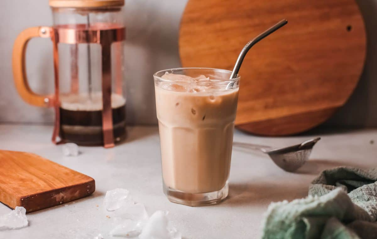 iced vanilla latte with french press in background