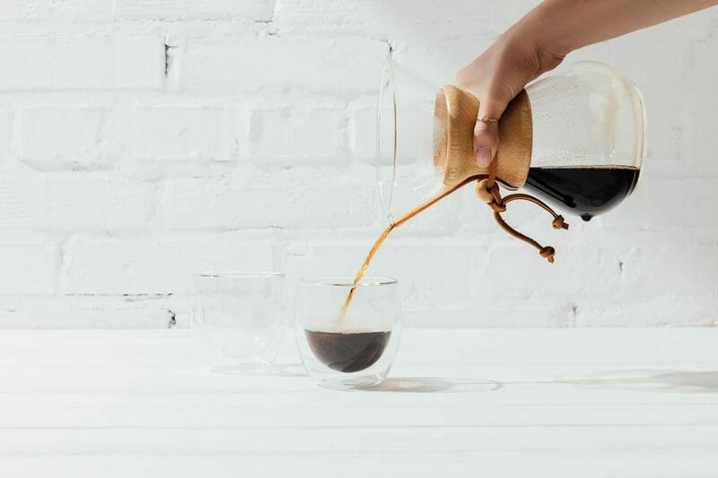 pouring brewed coffee from chemex into glass