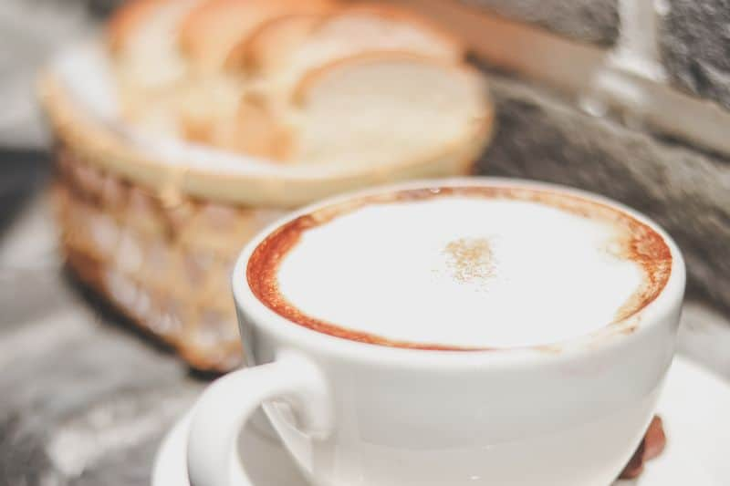 Traditional cappuccino coffee drink in white cup