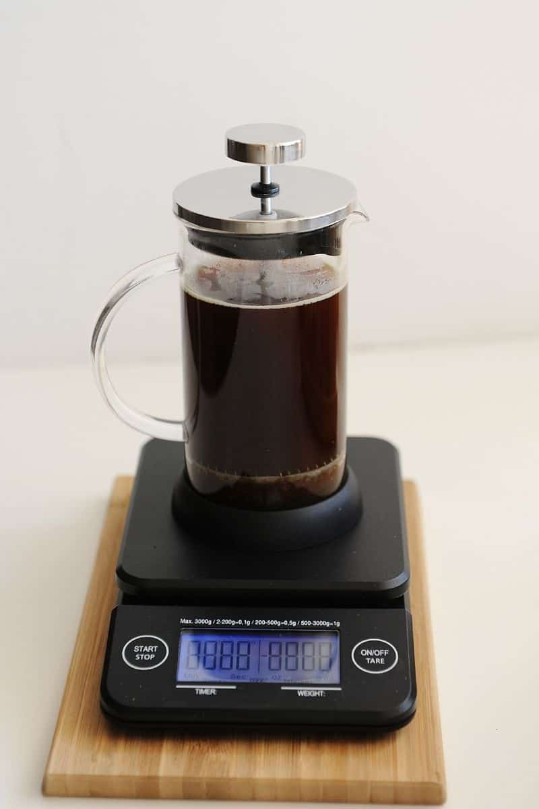 Coffee press on coffee scale brewing coffee
