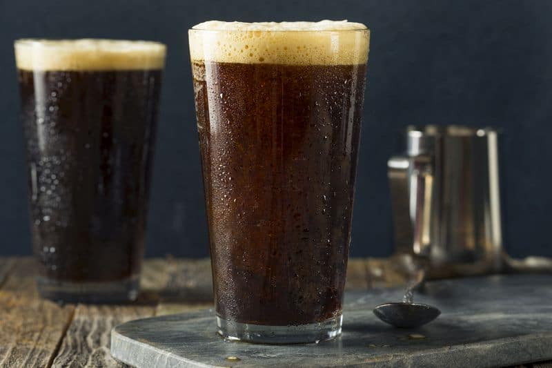 Frothy nitro cold brew coffee in tall glass