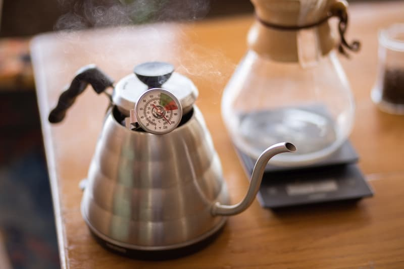 Close up of pour over coffee kettle with thermometer.