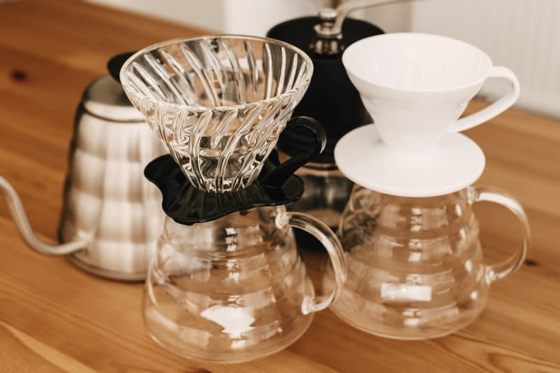 Alternative coffee brewing method. Glass carafe with plastic and ceramic dripper for pour-over coffee with a filter dripper.