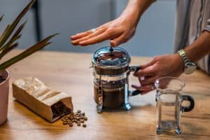 Pot of french press cold brew coffee on table