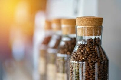 coffee beans stored in glass coffee container