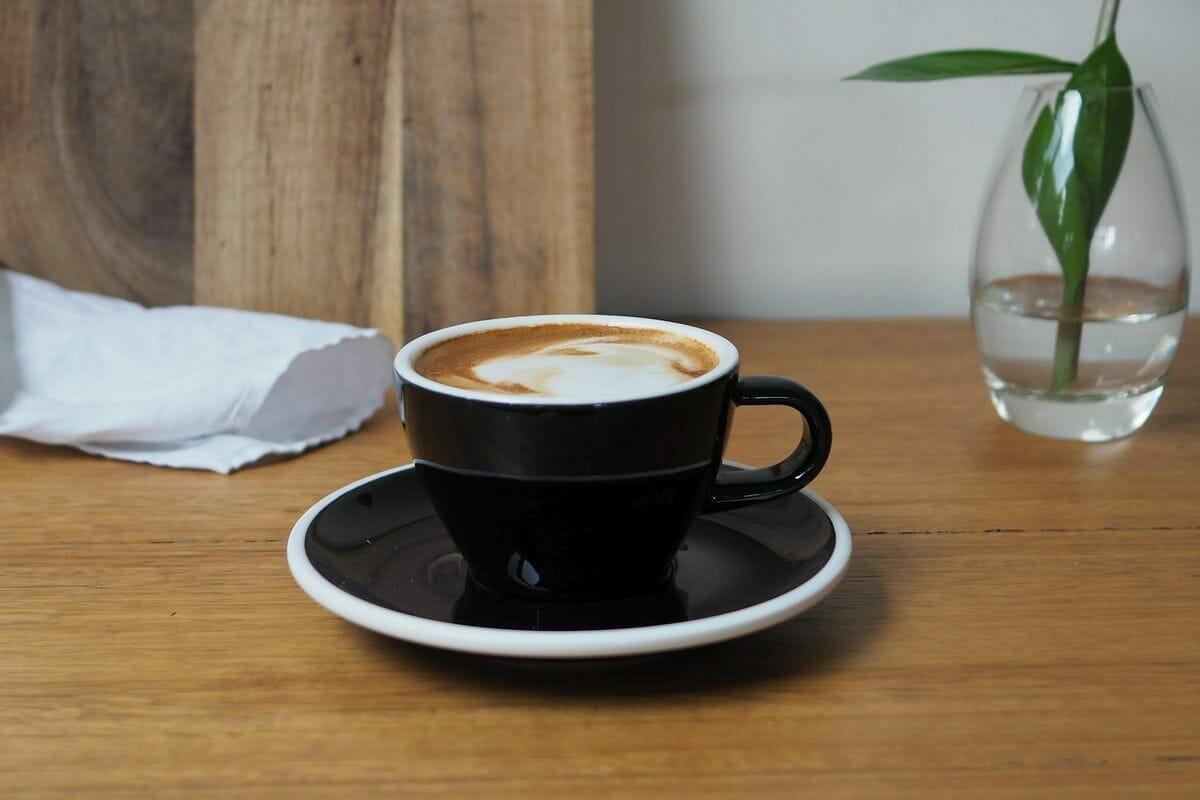 cup of magic coffee in black ceramic cup.